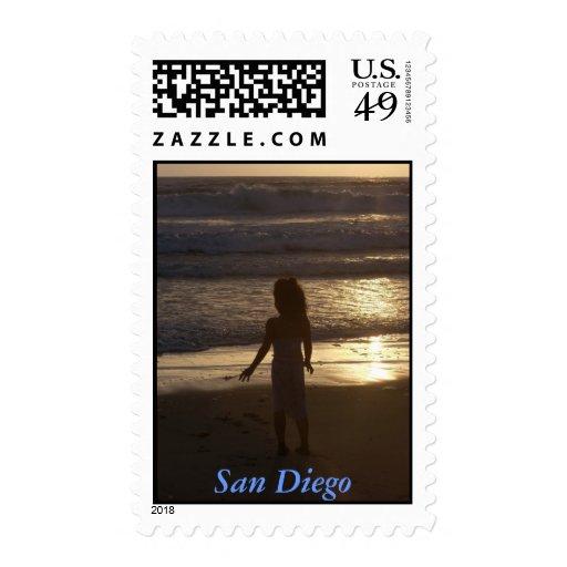 Puesta del sol de San Diego con el niño Sellos