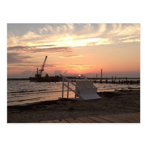 Puesta del sol de Sandy del huracán de la bahía de Postales