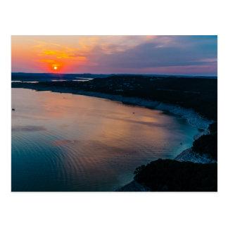 Puesta del sol de Travis del lago Tarjeta Postal