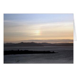 Puesta del sol del arco iris tarjeta de felicitación