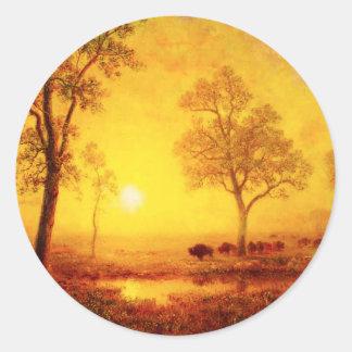 Puesta del sol del búfalo en los pegatinas de la pegatina redonda