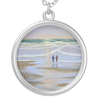 Puesta del sol del ~ del collar en la playa