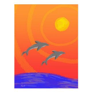 Puesta del sol del delfín tarjeta postal