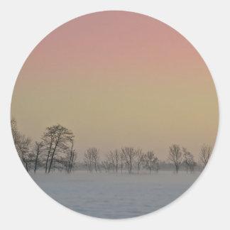 Puesta del sol del invierno pegatina redonda