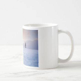 Puesta del sol del invierno taza