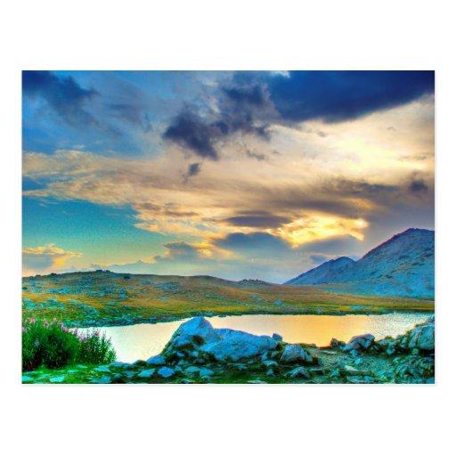Puesta del sol del lago postales