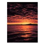 Puesta del sol del mar de Bering Postales