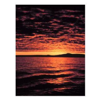 Puesta del sol del mar de Bering Postal