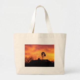 Puesta del sol del molino de viento bolsa lienzo