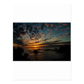 Puesta del sol del navidad tarjetas postales