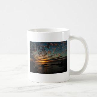 Puesta del sol del navidad tazas de café