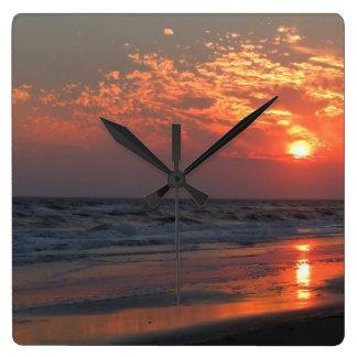 Puesta del sol del océano - isla del roble NC Relojes De Pared