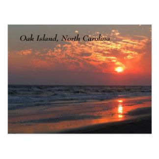 Puesta del sol del océano - isla del roble NC Postales