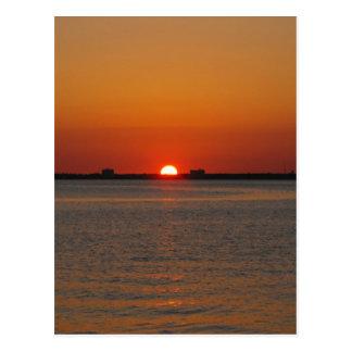 Puesta del sol del océano postales