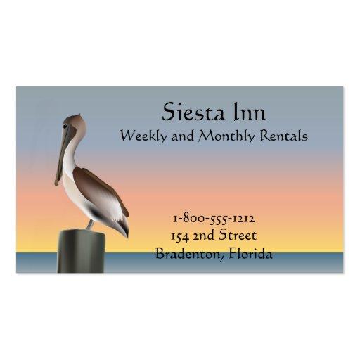 Puesta del sol del pelícano y de la gaviota tarjetas de visita