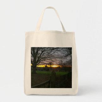 Puesta del sol del solsticio bolsas lienzo