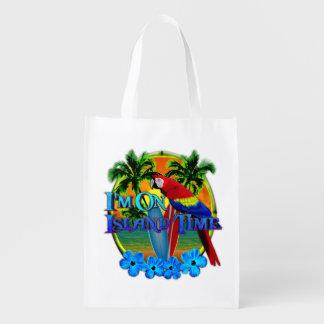 Puesta del sol del tiempo de la isla bolsas de la compra