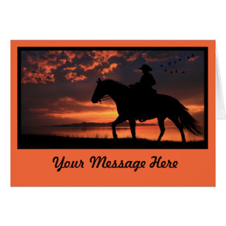 Puesta del sol del vaquero en naranja tarjetón