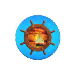 Puesta del sol del velero latas de caramelos