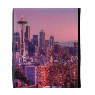 Puesta del sol detrás del horizonte de Seattle del