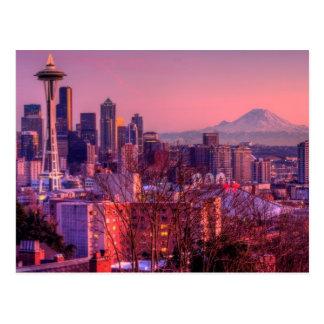Puesta del sol detrás del horizonte de Seattle del Postales