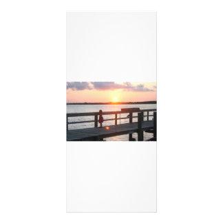 Puesta del sol detrás del muelle en la Florida con Lonas Publicitarias