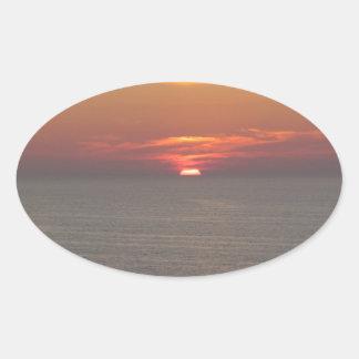 Puesta del sol en Clearwater Pegatina Ovalada