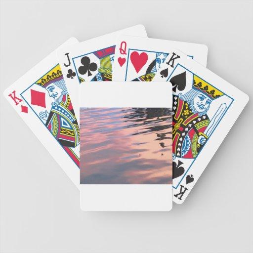 Puesta del sol en el agua baraja cartas de poker