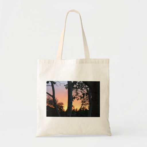 Puesta del sol en el bolso de los árboles bolsa tela barata