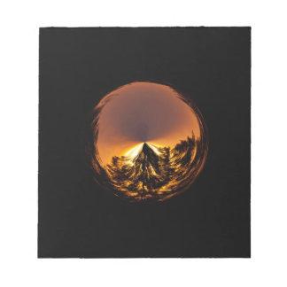 Puesta del sol en el globo blocs de papel