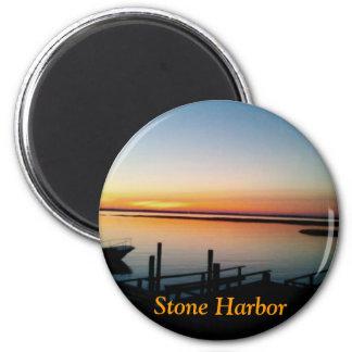 puesta del sol en el imán de la orilla