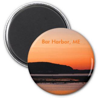 Puesta del sol en el imán del puerto de la barra
