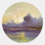 Puesta del sol en el mar pegatinas redondas