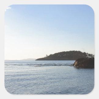 Puesta del sol en el océano calcomanía cuadradas