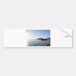 Puesta del sol en el océano pegatina para auto