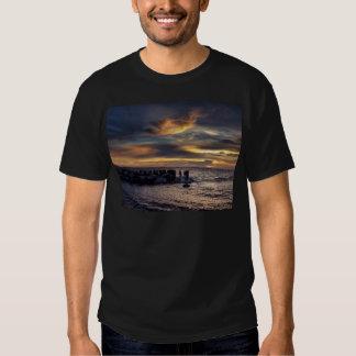 Puesta del sol en el puerto de Charleston Camisas