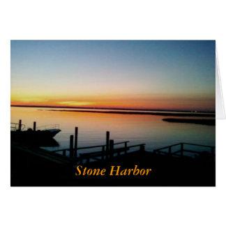 Puesta del sol en el puerto de piedra tarjeta de felicitación