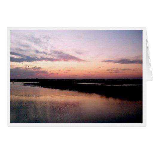 Puesta del sol en ensenada del refugio tarjeta