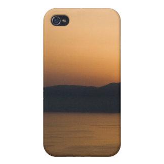 Puesta del sol en la distancia iPhone 4/4S fundas