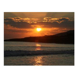 Puesta del sol en la playa de DA Luz del Praia, Al Postal
