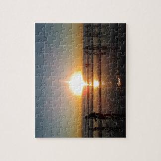 Puesta del sol en la playa puzzle con fotos