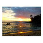 Puesta del sol en la playa tarjetas postales