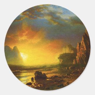 Puesta del sol en los pegatinas de la costa de Cal