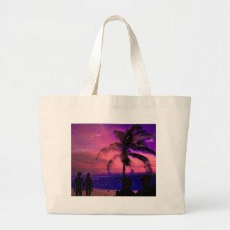 Puesta del sol en una playa, bolso de la playa bolsas