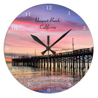 Puesta del sol espectacular en la playa de Newport Relojes