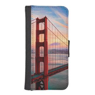 Puesta del sol hermosa del invierno en puente funda tipo billetera para iPhone 5