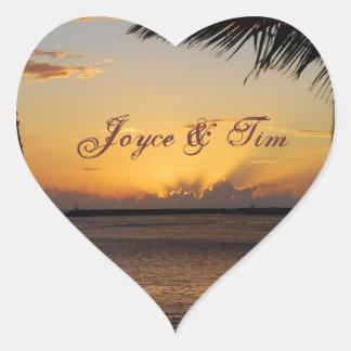 Puesta del sol hermosa del océano pegatina en forma de corazón