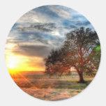 Puesta del sol hermosa etiqueta redonda