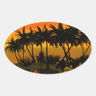 Puesta del sol hermosa sobre una isla de palma calcomanías de ovales