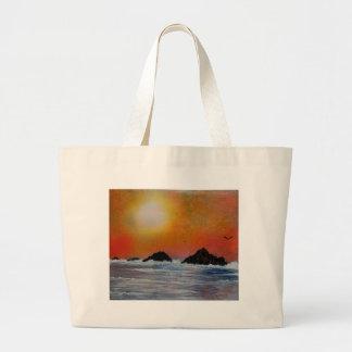 Puesta del sol hivernal en el mar bolsa tela grande